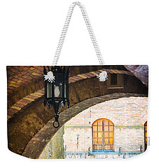 Weekender Tote Bag featuring the photograph Medieval Arches With Lamp by Silvia Ganora