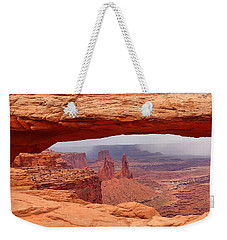 Weekender Tote Bag featuring the photograph Mesa Arch In Canyonlands National Park by Mitchell R Grosky
