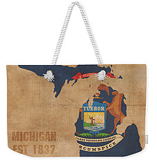 Michigan State Flag Map Outline With Founding Date On Worn Parchment Background Weekender Tote Bag