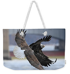 Weekender Tote Bag featuring the photograph Mid Air Fight by Coby Cooper