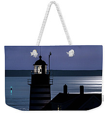 Weekender Tote Bag featuring the photograph Midnight Moonlight On West Quoddy Head Lighthouse by Marty Saccone