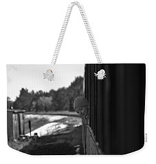 Weekender Tote Bag featuring the photograph Mischief by Jeremy Rhoades