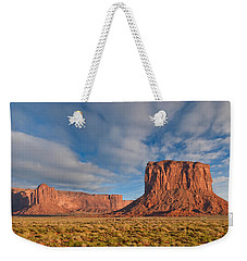 Weekender Tote Bag featuring the photograph Mitchell Butte And Gray Whiskers In The Evening Light by Jeff Goulden