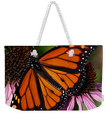 Weekender Tote Bag featuring the photograph Monarch On Purple Coneflower by Barbara McMahon