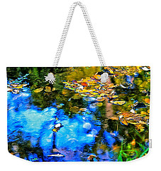 Weekender Tote Bag featuring the photograph Monet's Garden by Ira Shander