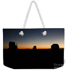 Weekender Tote Bag featuring the photograph Monument Valley Sunrise by Jeff Kolker