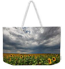 Moody Skies Over The Sunflower Fields Weekender Tote Bag