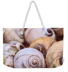 Weekender Tote Bag featuring the photograph Moon Snail Shells by Peggy Collins