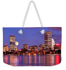 Weekender Tote Bag featuring the photograph Moonlit Boston On The Charles by Mitchell R Grosky