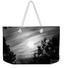 Weekender Tote Bag featuring the photograph Moonlit Clouds by Todd Blanchard