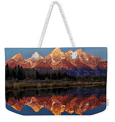 Weekender Tote Bag featuring the photograph Morning Glory by Benjamin Yeager