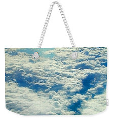 Weekender Tote Bag featuring the photograph Mostly Cloudy by Mark Greenberg