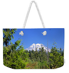 Weekender Tote Bag featuring the photograph Mount Rainier by Gordon Elwell