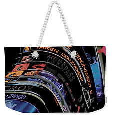Weekender Tote Bag featuring the photograph Movie Madness by Pennie  McCracken