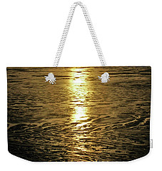 Weekender Tote Bag featuring the photograph Muddy Reflection by Jeremy Rhoades