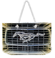 Weekender Tote Bag featuring the photograph Mustang Emblem by Victor Montgomery