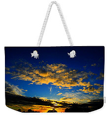 Weekender Tote Bag featuring the photograph Mysterious Sunset by Mark Blauhoefer