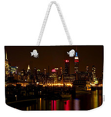Weekender Tote Bag featuring the photograph New York City by Dave Files