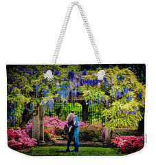 Weekender Tote Bag featuring the photograph New York Lovers In Springtime by Chris Lord