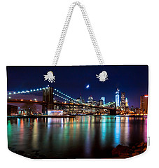 Weekender Tote Bag featuring the photograph New York Skyline And Brooklyn Bridge With Crescent Moon Rising by Mitchell R Grosky