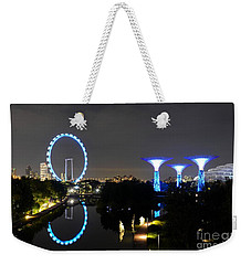 Night Shot Of Singapore Flyer Gardens By The Bay And Water Reflections Weekender Tote Bag