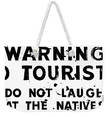 Weekender Tote Bag featuring the photograph No Laughing by Benjamin Yeager