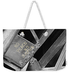 Weekender Tote Bag featuring the photograph No Peace No Justice by Patricia Babbitt