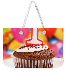 Weekender Tote Bag featuring the photograph Chocolate Cupcake With One Burning Candle by Vizual Studio