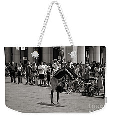 Weekender Tote Bag featuring the photograph Nycity Street Performer by Angela DeFrias