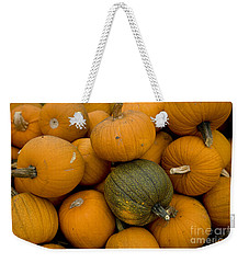 Weekender Tote Bag featuring the photograph Odd One Out by David Millenheft