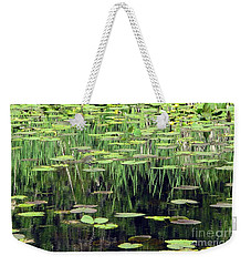 Weekender Tote Bag featuring the photograph Ode To Monet by Chris Anderson
