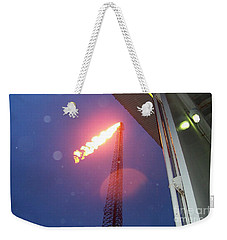 Weekender Tote Bag featuring the photograph Oil Platform Flare Boom During Hurricane Cindy Off The Coast Of Louisiana In The Gulf Of Mexico by Michael Hoard
