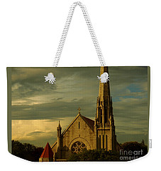 Weekender Tote Bag featuring the photograph Old Church With Dramatic Clouds And Sky At Sunset by Miriam Danar