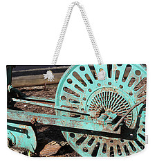 Weekender Tote Bag featuring the photograph Old Farm Equipment by Todd Blanchard