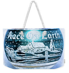 Weekender Tote Bag featuring the photograph Christmas Tree Ornament Peace On Earth  by Vizual Studio