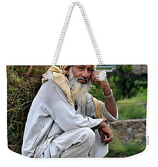 Weekender Tote Bag featuring the photograph Old Man Carrying Fodder Swat Valley Kpk Pakistan by Imran Ahmed