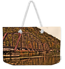 Weekender Tote Bag featuring the photograph Old Railroad Bridge With Sepia Tones by Jonny D