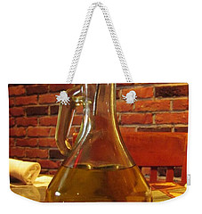 Weekender Tote Bag featuring the photograph Olive Oil On Table by Cynthia Guinn