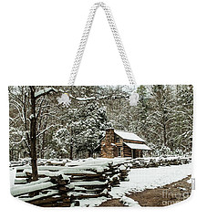 Weekender Tote Bag featuring the photograph Oliver's Log Cabin Nestled In Snow by Debbie Green