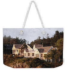 Weekender Tote Bag featuring the photograph On A Cliff By The Sea by Jean Goodwin Brooks