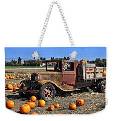 Weekender Tote Bag featuring the photograph One More Pumpkin by Michael Gordon