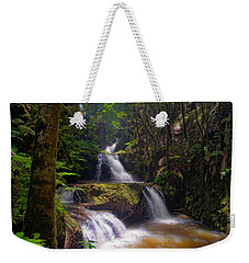 Weekender Tote Bag featuring the photograph Onomea Falls by Jim Thompson