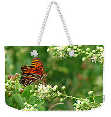 Weekender Tote Bag featuring the photograph Orange Butterfly by Marcia Socolik