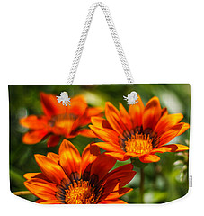 Weekender Tote Bag featuring the photograph Orange Flowers by Jane Luxton