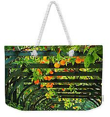 Weekender Tote Bag featuring the photograph Oranges And Lemons On A Green Trellis by Brooke T Ryan