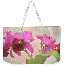 Weekender Tote Bag featuring the photograph Orchid In Hot Pink by Rosalie Scanlon