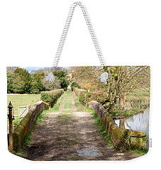 Weekender Tote Bag featuring the photograph Over The River by Wendy Wilton