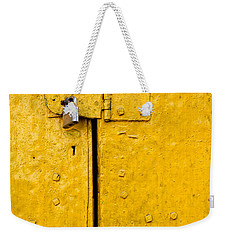 Padlock On An Old Yellow Door Weekender Tote Bag