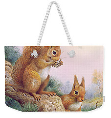 Pair Of Red Squirrels On A Scottish Pine Weekender Tote Bag by Carl Donner