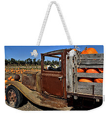 Weekender Tote Bag featuring the photograph Pale Rider by Michael Gordon